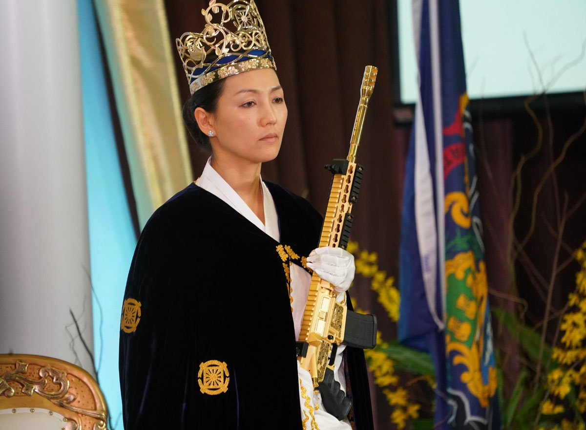 Rev. Yeon Ah Lee Moon, wife of Rev. Hyung Jin Moon, holds weapon as worshippers at World Peace and Unification Sanctuary attend services February 28, 2018 in New Foundland, Pennsylvania.