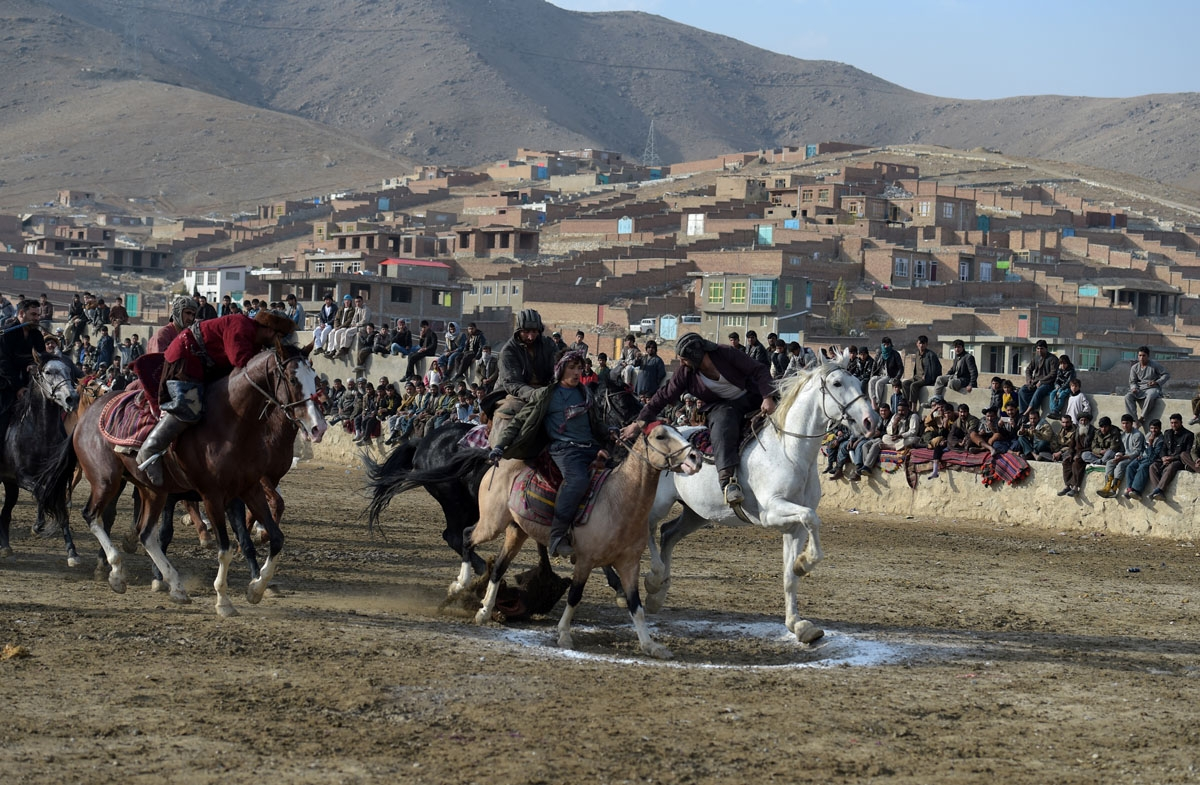 This photo taken on December 1, 2017 shows Afghan horsemen competing during a game of the traditional sport of buzkashi on the outskirts of Kabul.
