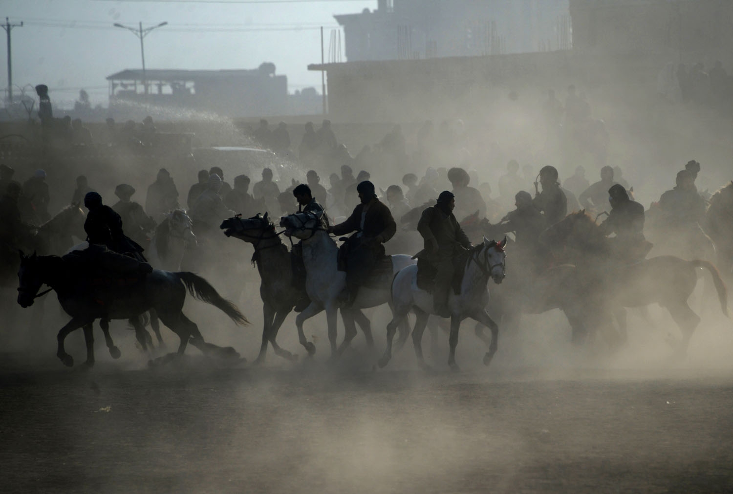 In this photograph taken on December 15, 2017, Afghan horsemen compete during a game of the traditional sport of Buzkashi in Mazar-i-Sharif.