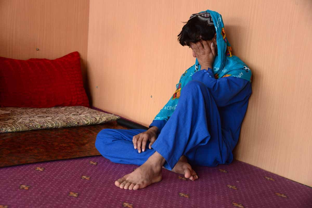 This file photo taken on October 31, 2016 shows an Afghan boy, who was held as a child sex slave, sitting at a restaurant in a unidentified location in Afghanistan.