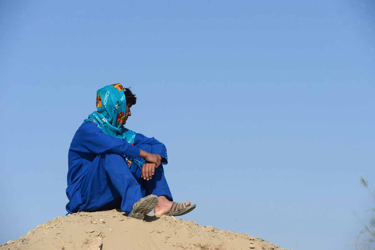 This file photo taken on October 31, 2016 shows an Afghan boy, who was held as a child sex slave, as he sits at a unidentified location in Afghanistan.