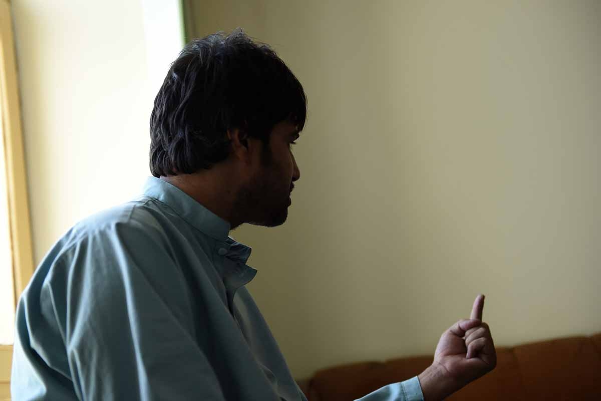 This file photo taken on October 5, 2016 shows Shirin, the brother-in-law of a bacha bazi victim, a teenage boy, gesturing as he talks during an interview with AFP in Lashkar Gah of Helmand province.