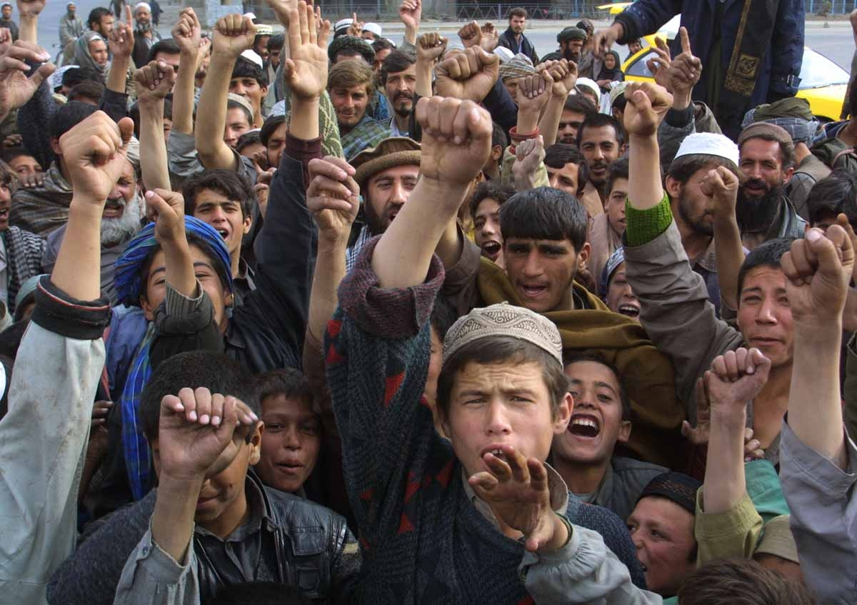 Local residents shout 'Allah Akbar' 13 November 2001 in Kabul, after Northern Alliance captured the capital.