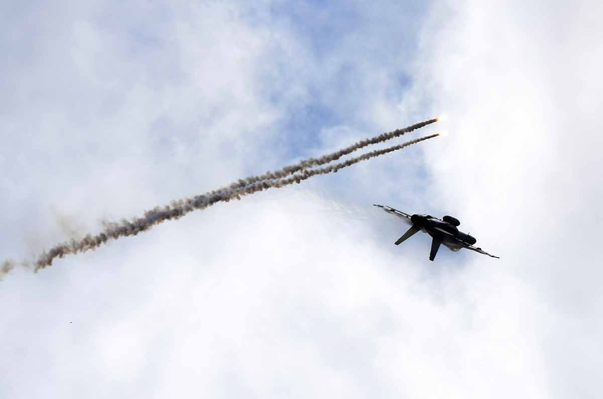 A Royal Australian Air Force F/A-18 Hornet aircraft launches flares in flight during the Australian International Airshow in Melbourne on March 5, 2017.