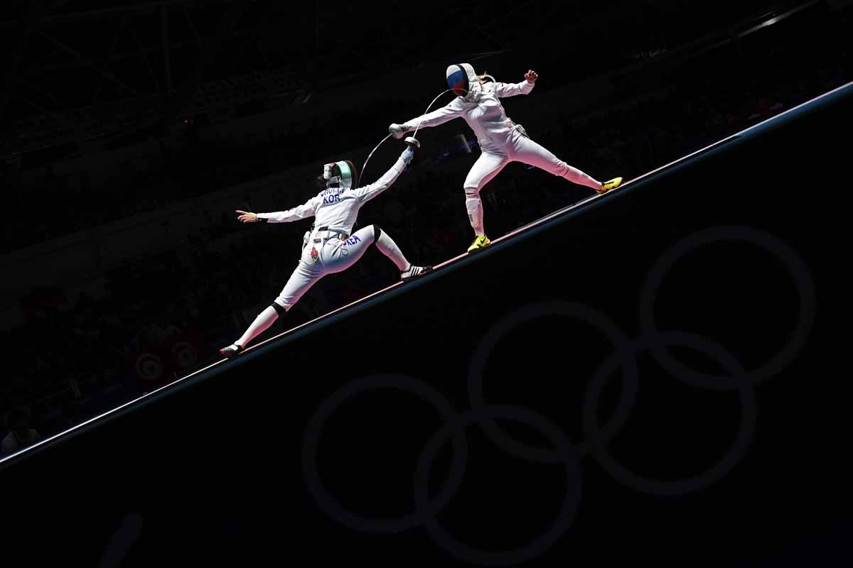 South Korea's Choi Injeong (L) competes against Russia's Violetta Kolobova during their women's individual epee qualifying bout as part of the fencing event of the Rio 2016 Olympic Games, on August 6, 2016, at the Carioca Arena 3, in Rio de Janeiro.