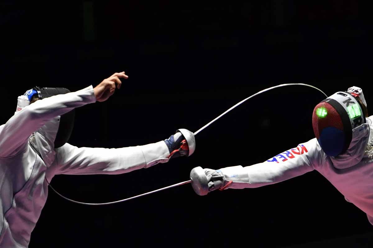 South Korea's Park Sangyoung (R) competes against Switzerland's Benjamin Steffen during their men's individual epee semi-final bout as part of the fencing event of the Rio 2016 Olympic Games, on August 9, 2016, at the Carioca Arena 3, in Rio de Janeiro.