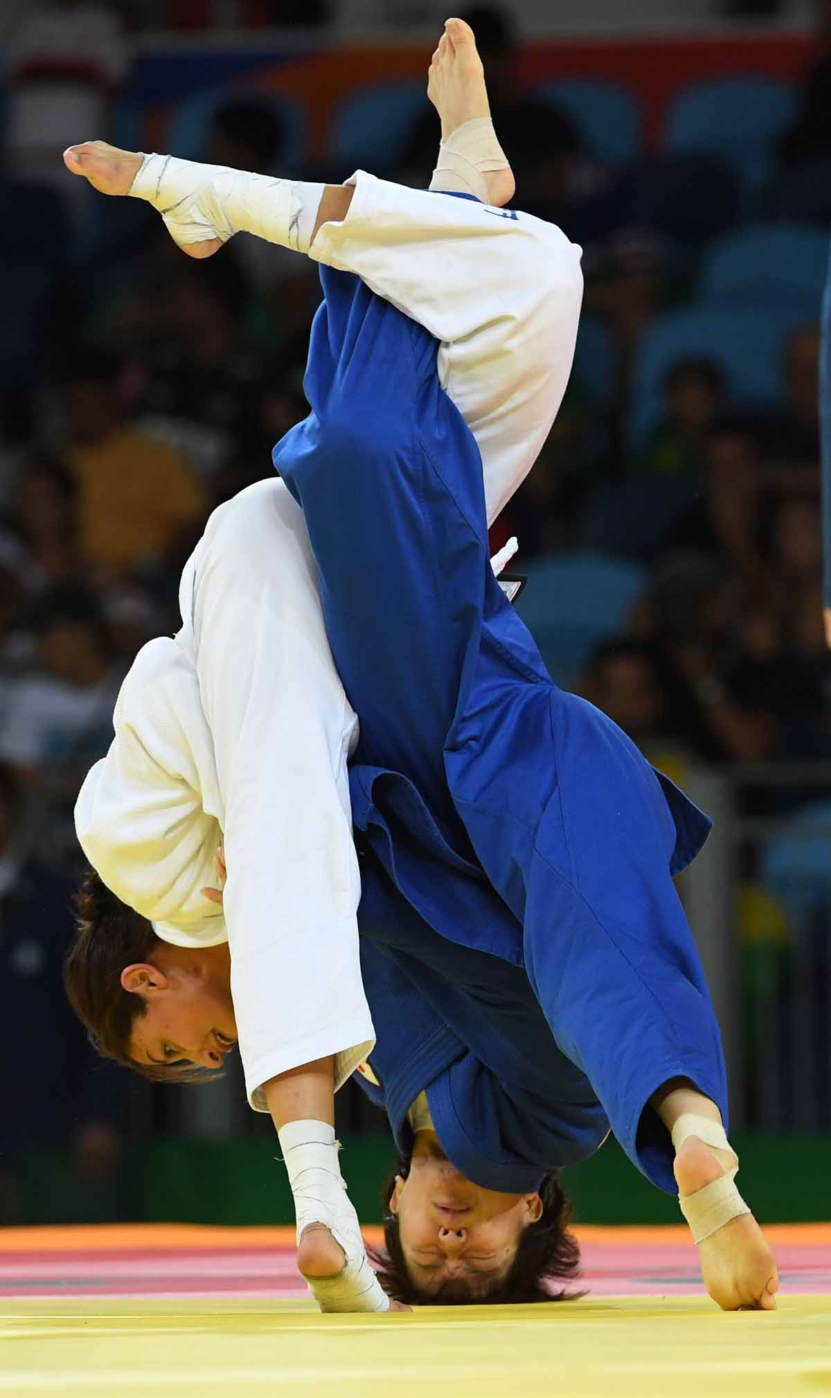 Israel's Yarden Gerbi (white) competes with Japan's Miku Tashiro during their women's -63kg judo contest bronze medal A match of the Rio 2016 Olympic Games in Rio de Janeiro on August 9, 2016.