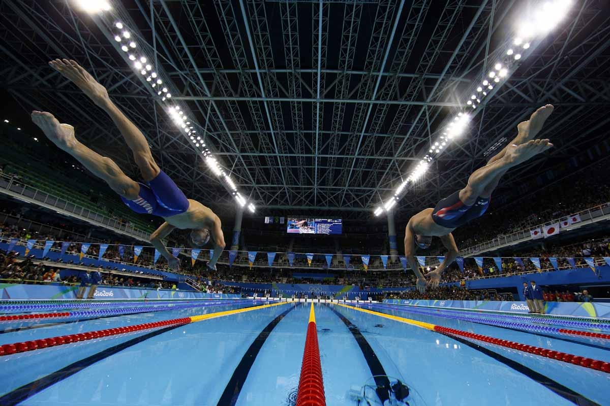 USA's Michael Phelps (L) takes the start of the Men's 200m Individual Medley Semifinal during the swimming event at the Rio 2016 Olympic Games at the Olympic Aquatics Stadium in Rio de Janeiro on August 10, 2016.