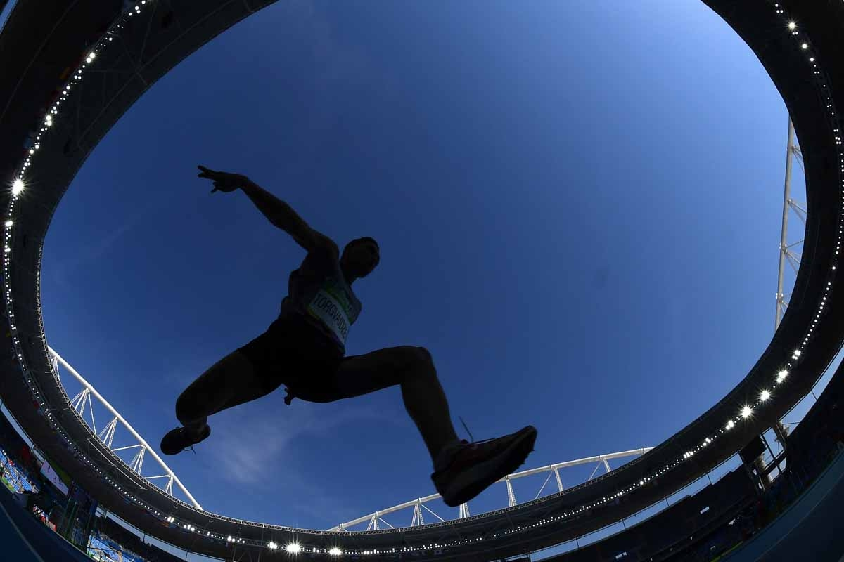 Georgia's Lasha Torgvaidze competes in the Men's Triple Jump Qualifying Round as part of the athletics competition at the Rio 2016 Olympic Games at the Olympic Stadium in Rio de Janeiro on August 15, 2016.