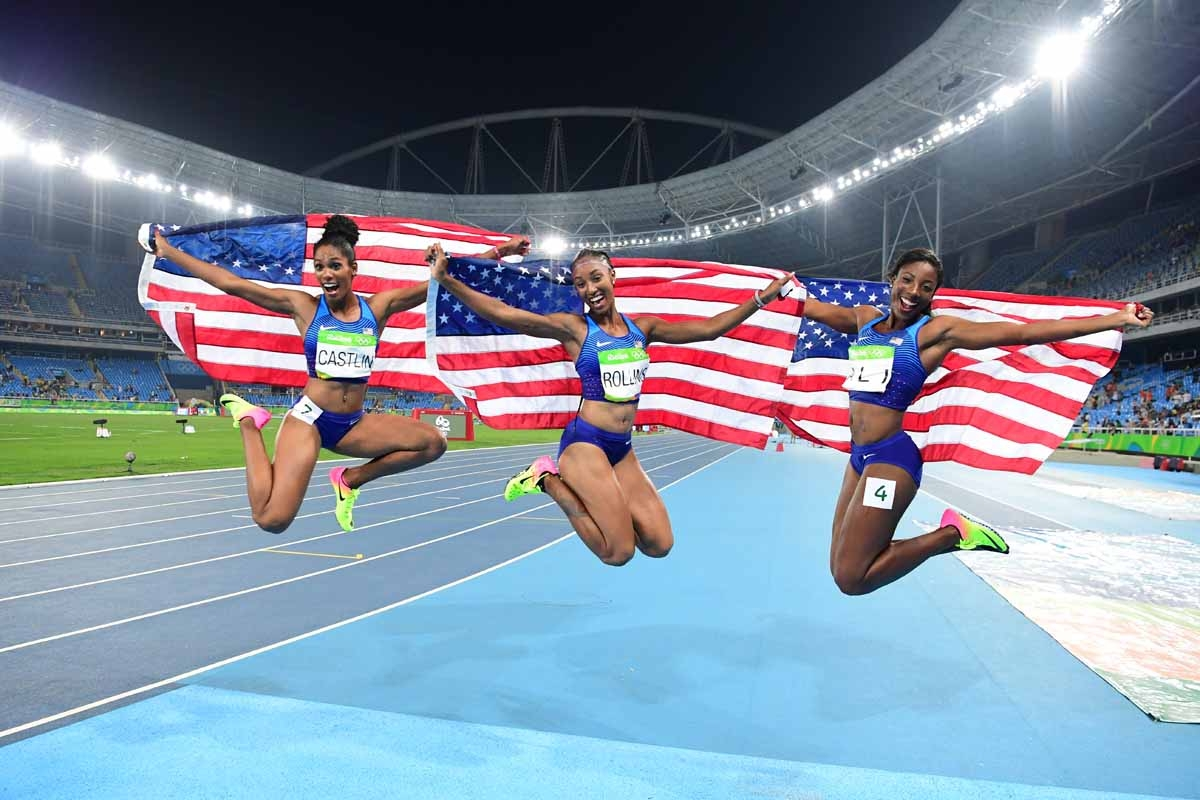 (L-R) Bronze medallist USA's Kristi Castlin, gold medallist USA's Brianna Rollins and silver medallist USA's Nia Ali celebrate after the Women's 100m Hurdles Final during the athletics event at the Rio 2016 Olympic Games at the Olympic Stadium in Rio de J