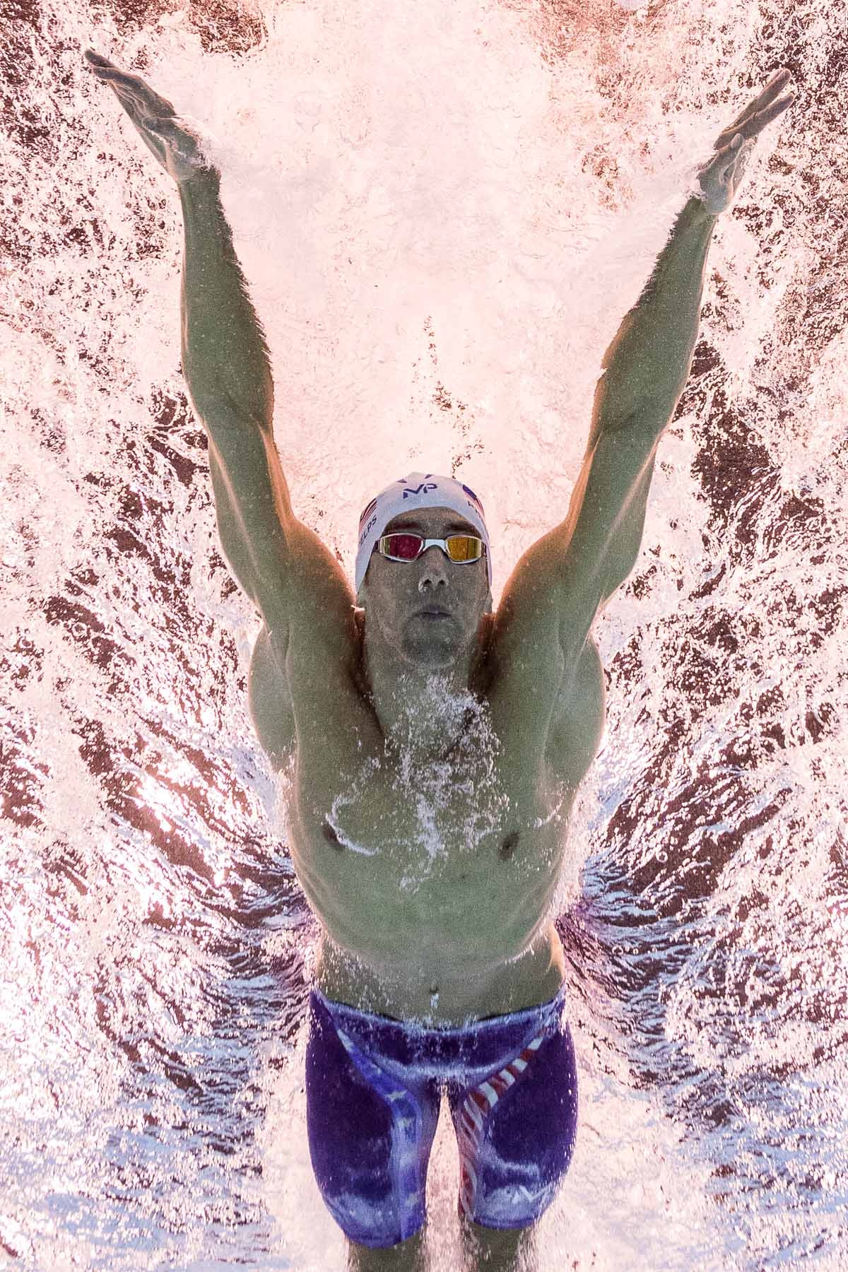USA's Michael Phelps competes in a Men's 100m Butterfly heat during the swimming event at the Rio 2016 Olympic Games at the Olympic Aquatics Stadium in Rio de Janeiro on August 11, 2016.