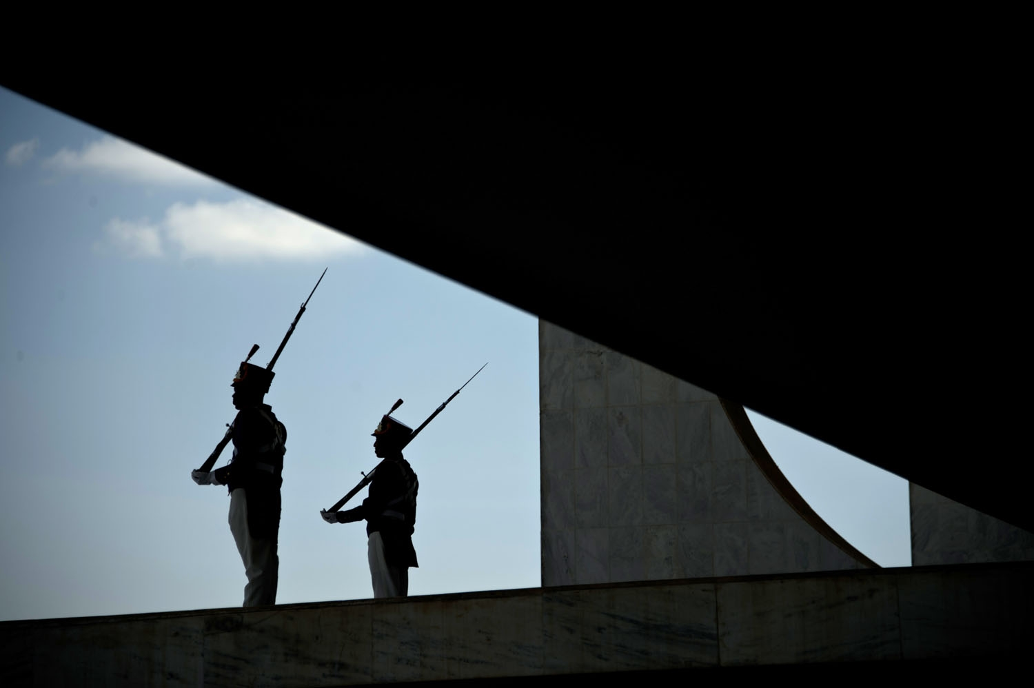 Presidential protocol guards are silhouted at the Planalto palace in Brasilia on May 11, 2016.