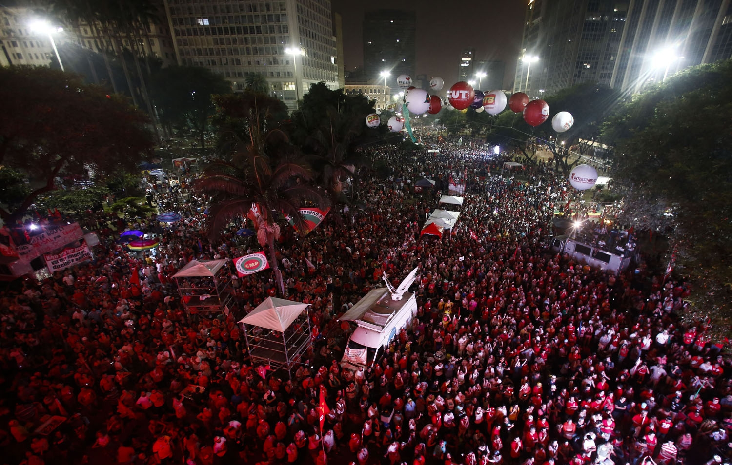 Supporters of Brazilian President Dilma Rousseff follow on big screens in Sao Paulo, the voting of lawmakers at the Congress in Brasilia on whether the impeachment of Rousseff will move forward, on April 17, 2016