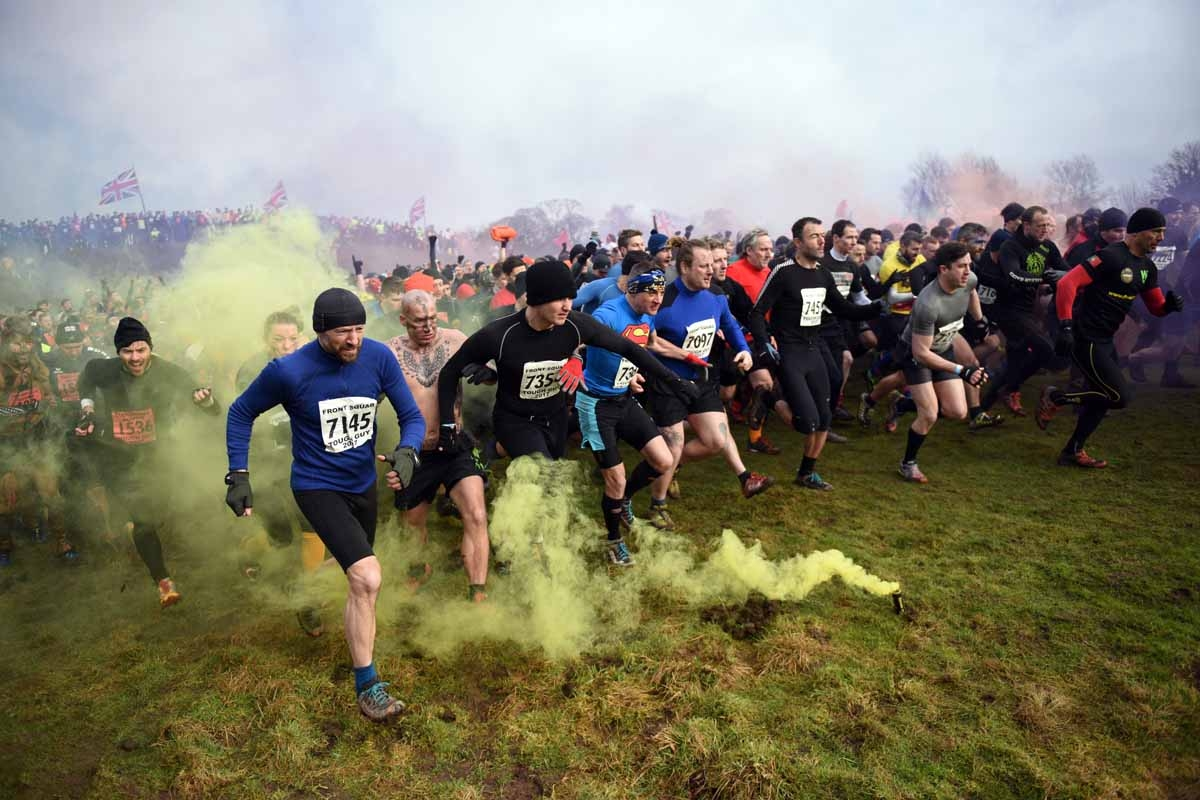 Competitors start the 'Tough Guy' adventure race near Wolverhampton, central England, on January 29, 2017.  The Tough Guy event, which is being held for the final time in its 30th year, challenges thousands of competitors to run a gruelling course whilst