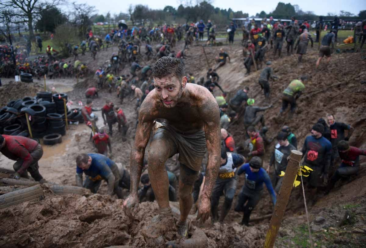 Competitors take part in the 'Tough Guy' adventure race near Wolverhampton, central England, on January 29, 2017.  The Tough Guy event, which is being held for the final time in its 30th year, challenges thousands of competitors to run a gruelling course