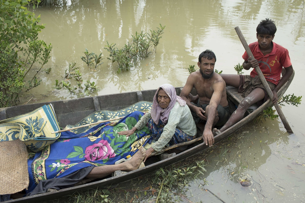 EDITORS NOTE: Graphic content / The bodies of Rohingya refugee are brought to shore on a boat by fellow Rohingyas after being recovered on the Naf river, as scores of refugees tried to flee from Myanmar to Bangladesh, near Ulubunia in Ukhiya on September