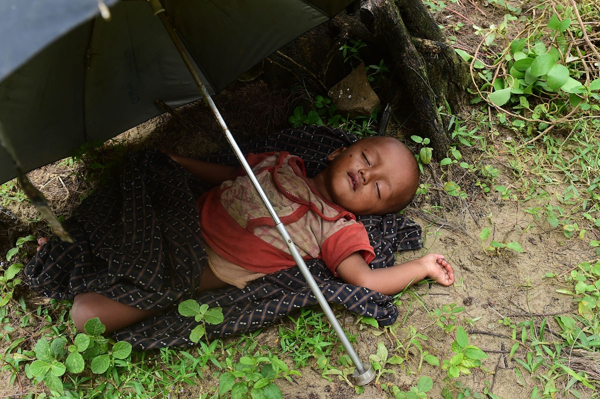 A Rohingya Muslim child sleeps after crossing the border from Myanmar, near the Bangladeshi town of Teknaf on September 10, 2017.