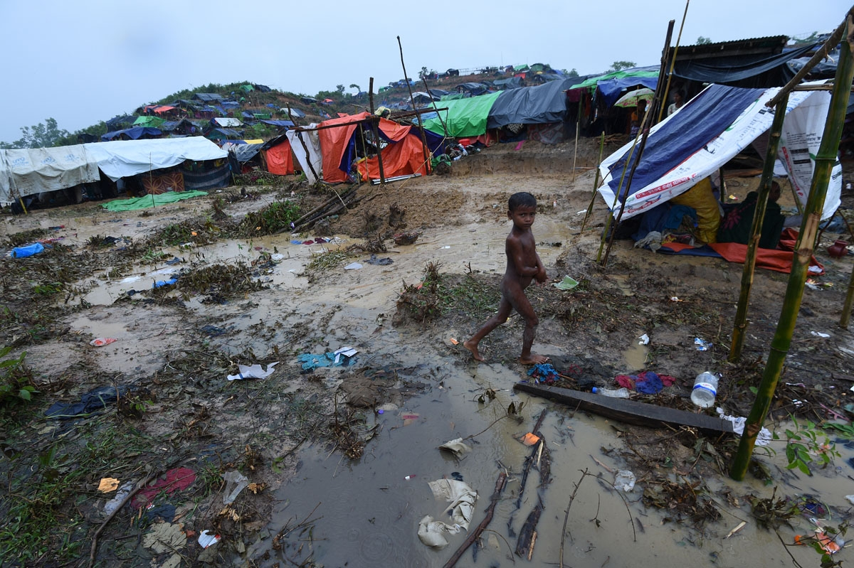 A Rohingya Muslim refugee child walks through Balukhali refugee camp near the Bangladesh town of Gumdhum on September 17, 2017.
