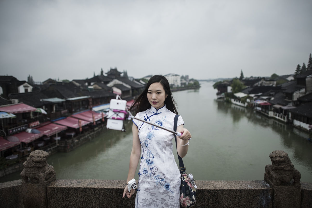 In this picture taken on September 7, 2016, a woman takes a selfie in Zhujiajiao, on the outskirts of Shanghai