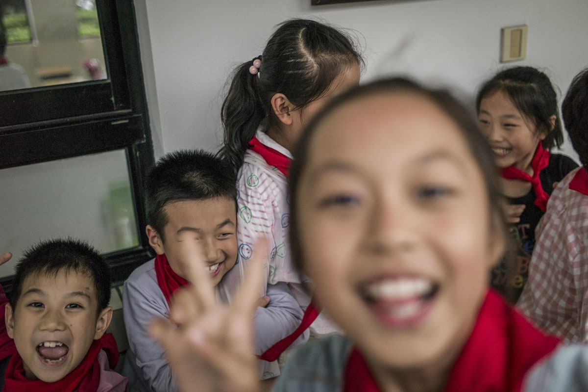 In this picture taken on September 8, 2016, students pose for a picture at the elementary school in Zhujiajiao, on the outskirts of Shanghai