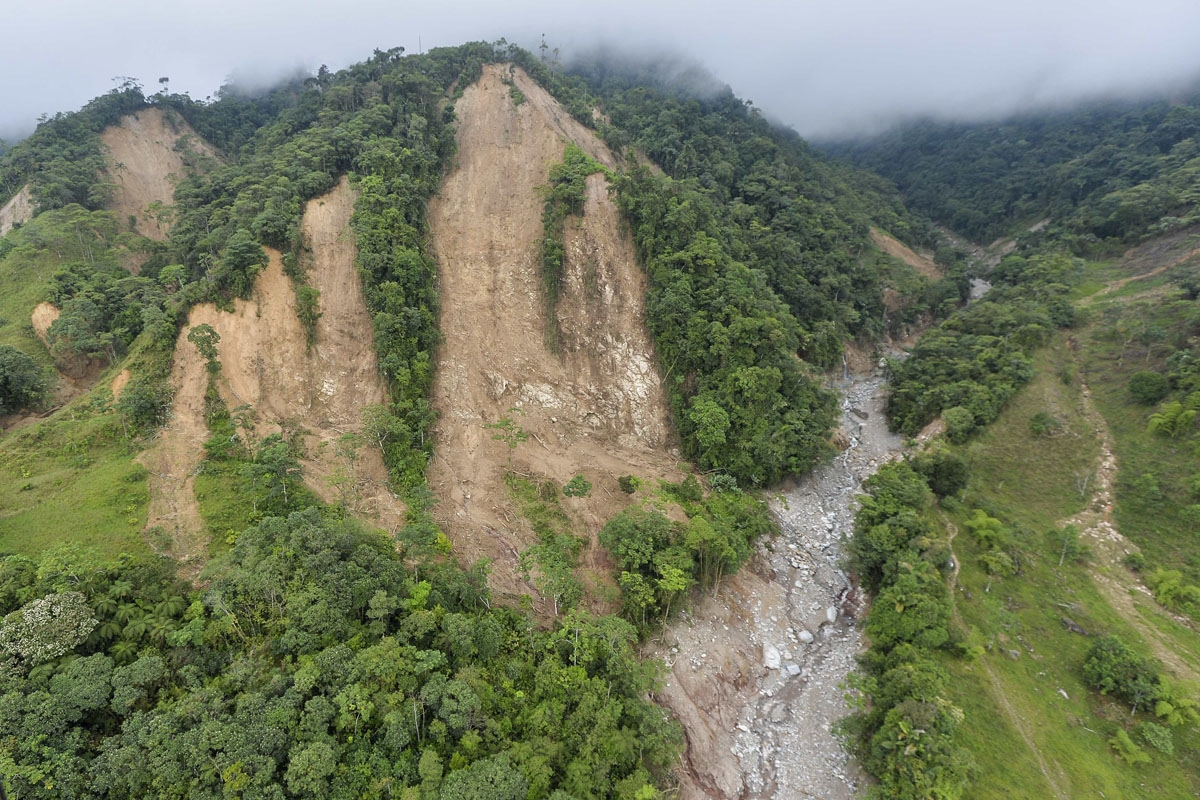 This aerial view shows one of the landslides in the mountains that caused the mudslides as a result of heavy rains, in Mocoa, Putumayo department, Colombia on April 3, 2017.