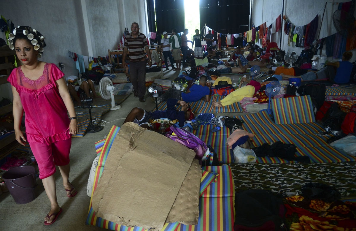 Cuban migrants rest in a shelter in the Turbo municipality, Antioquia department, Colombia, on June 14, 2016