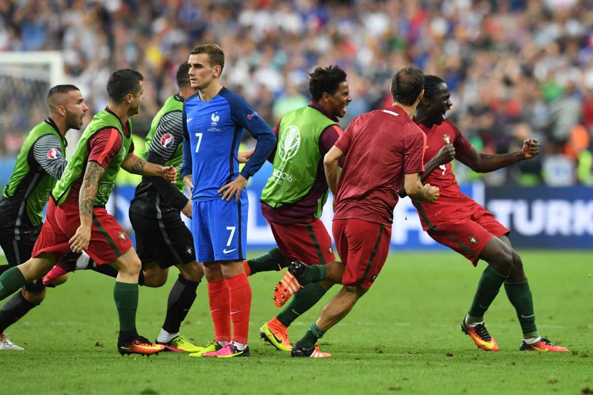 Portugal's forward Eder (R) celebrates with teammates past France's forward Antoine Griezmann (C) after he scored during the Euro 2016 final football match between Portugal and France at the Stade de France in Saint-Denis, north of Paris, on July 10, 2016