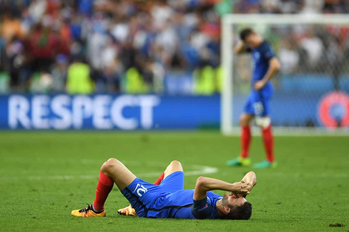 France's forward Andre-Pierre Gignac reacts after Portugal won the Euro 2016 final football match between Portugal and France at the Stade de France in Saint-Denis, north of Paris, on July 10, 2016. / AFP PHOTO / PATRIK STOLLARZ