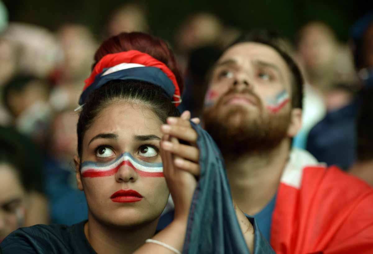 A French supporter reacts after the Euro 2016 final football match between Portugal and France at the Champ-de-Mars fan zone in Paris on July 10, 2016. Ronaldo's Portugal beat France 1-0 in Euro 2016 final. / AFP PHOTO / ALAIN JOCARD