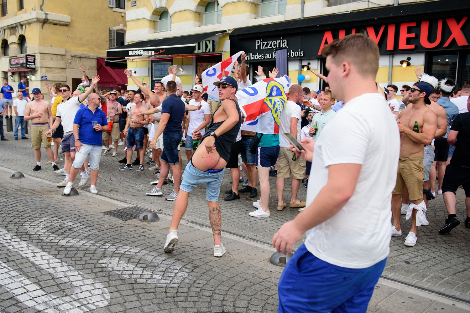 England fans taunt French fans in Marseille, southern France, on June 10, 2016, ahead of England's Euro 2016 football match against Russia on June 11, 2016