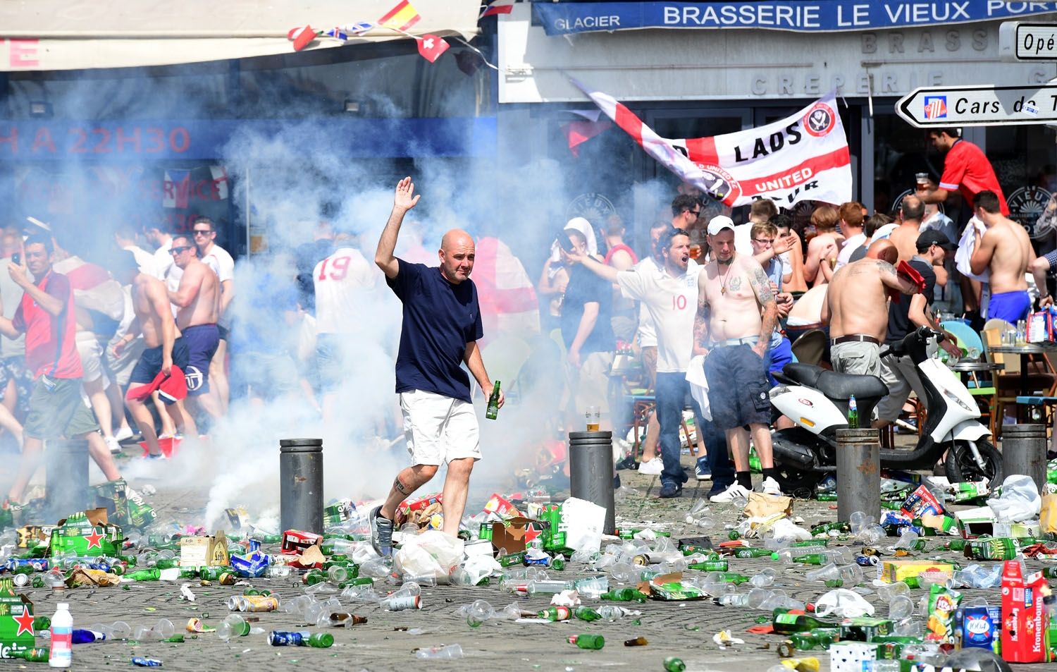 Tear gas is fired at England fans as they gather in the city of Marseille, southern France, on June 11, 2016