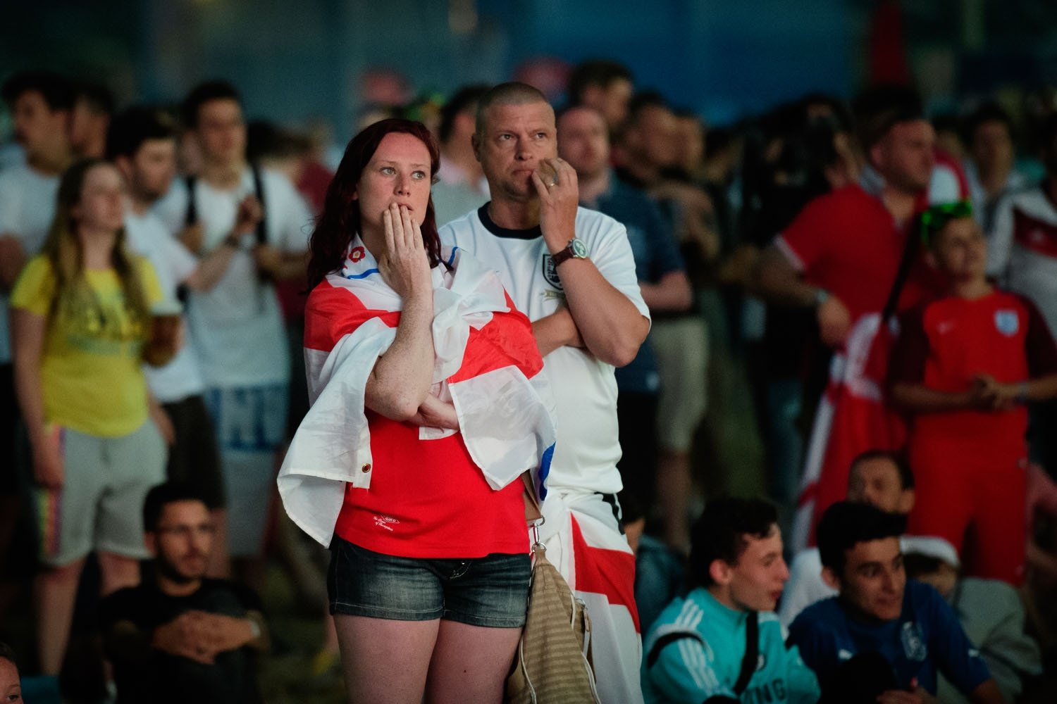 England supporters react as they watch the Euro 2016 group B football match between England and Russia from the fanzone in Marseille, on June 11, 2016