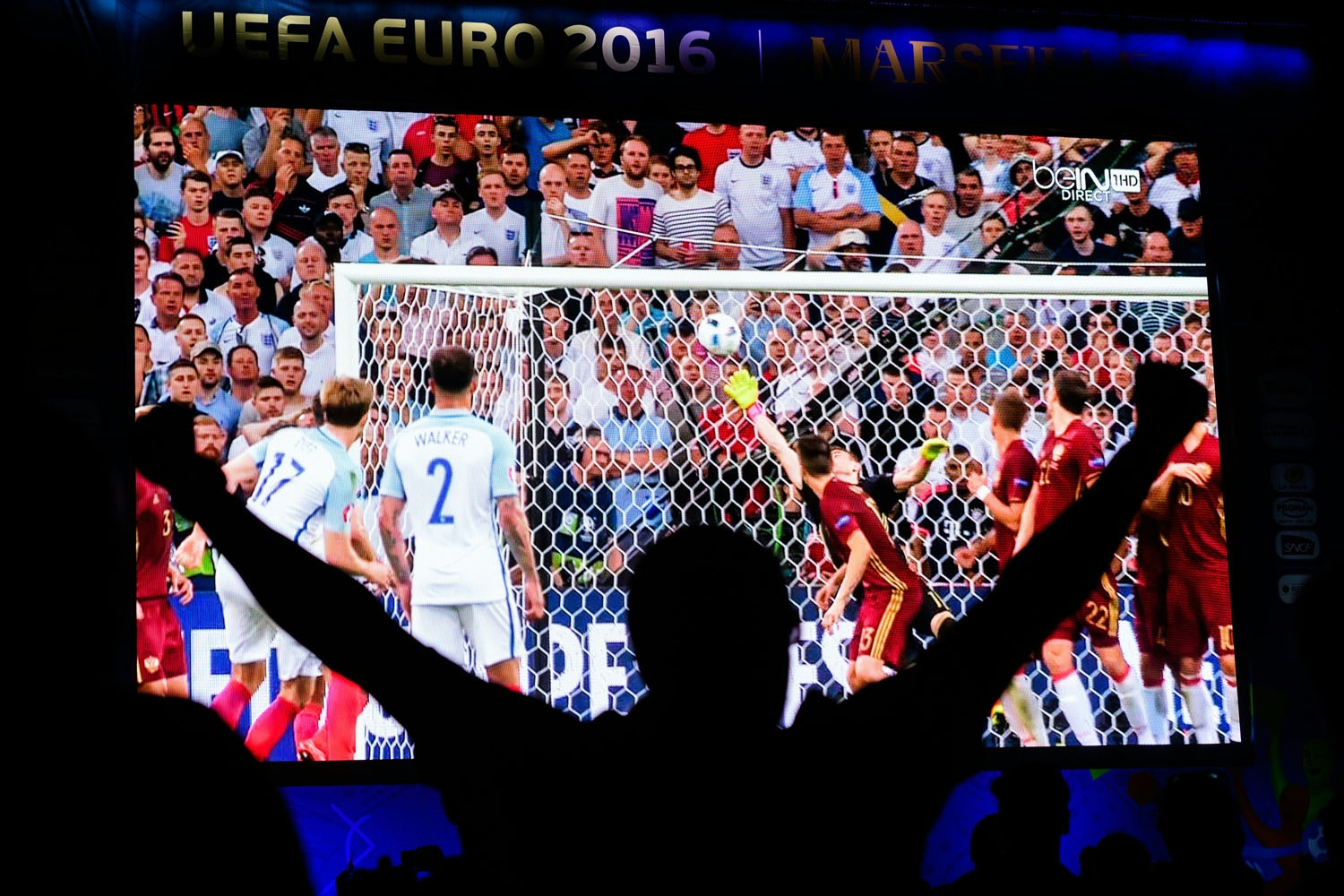 An England fan celebrates in the fanzone in Marseille after England's midfielder Eric Dier scored during the Euro 2016 group B football match between England and Russia, on June 11, 2016