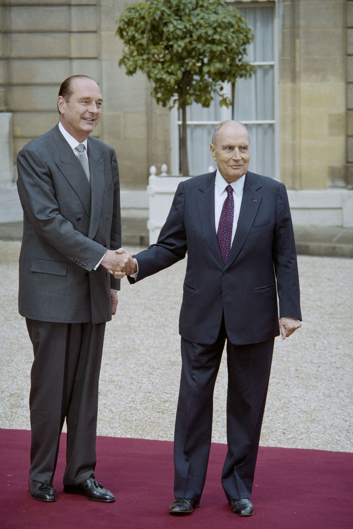 French outgoing President Francois Mitterrand (R) shakes hands with his successor Jacques Chirac during the formal handover of power ceremony on May 17, 1995 at the Elysee Palace in Paris.