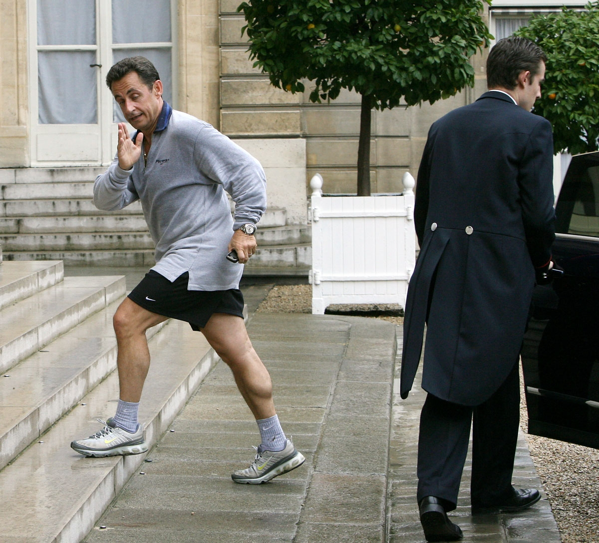 French president Niclas Sarkozy enters the Elysee palace after a jogging with Francois Fillon (not pictured), an hour after being appointed prime minister, 17 May 2007 in Paris.