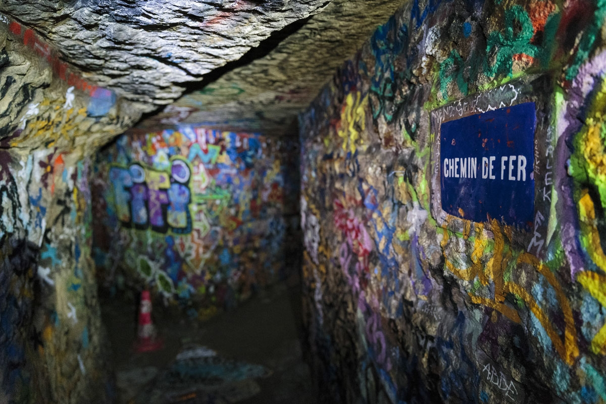 In this photograph taken on November 7, 2017, shows a street sign in a colorful part of the banned catacombs of Paris.