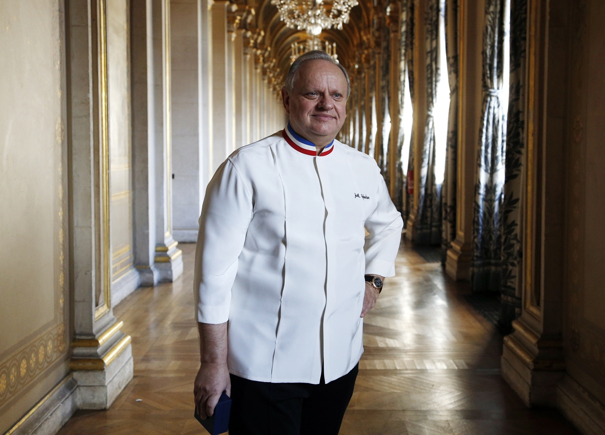 (FILES) In this file photo taken on January 14, 2016 French chef Joel Robuchon poses in a corridor in the Hotel de ville of Paris during the Grand Vermeil award ceremony, rewarding the best chefs of Paris. French chef, died at the age of 73, on August 6,