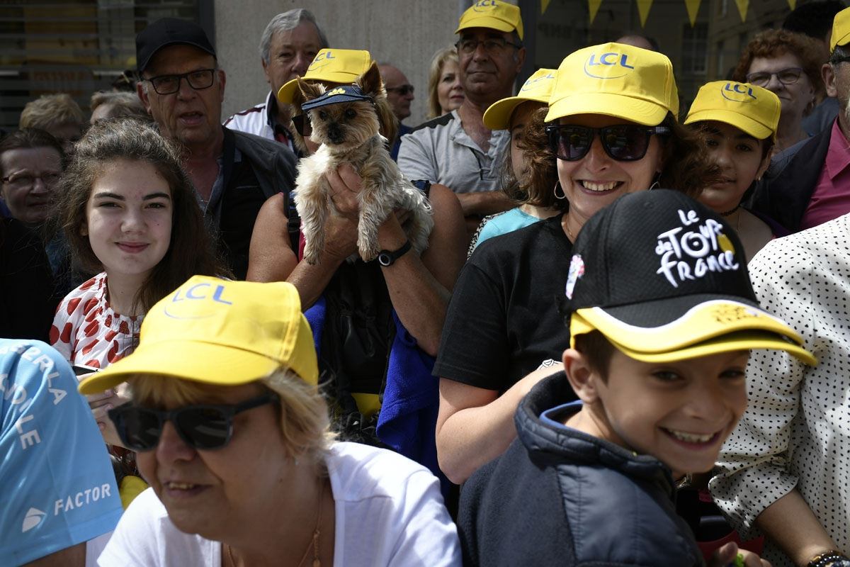 Supporters wait for riders near the finish line during the 212,5 km third stage of the 104th edition of the Tour de France cycling race on July 3, 2017 between Verviers, Belgium and Longwy, France.