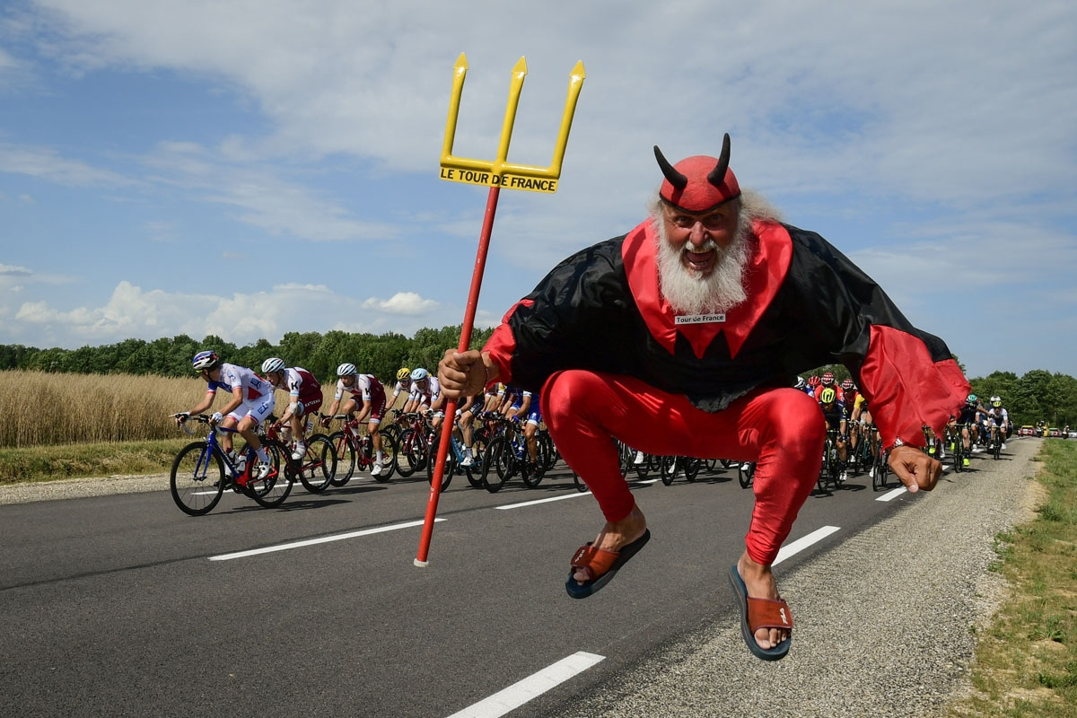 German supporter Didi Senft known as El Diablo jumps as the pack ride during the 213,5 km seventh stage of the 104th edition of the Tour de France cycling race on July 7, 2017 between Troyes and Nuits-Saint-Georges.