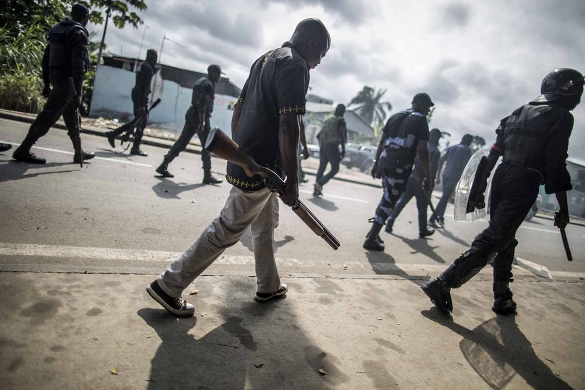 Gabonese police forces patrol as they clear barricades in the streets adjacent to the National Assembly, in Libreville, on September 1, 2016.