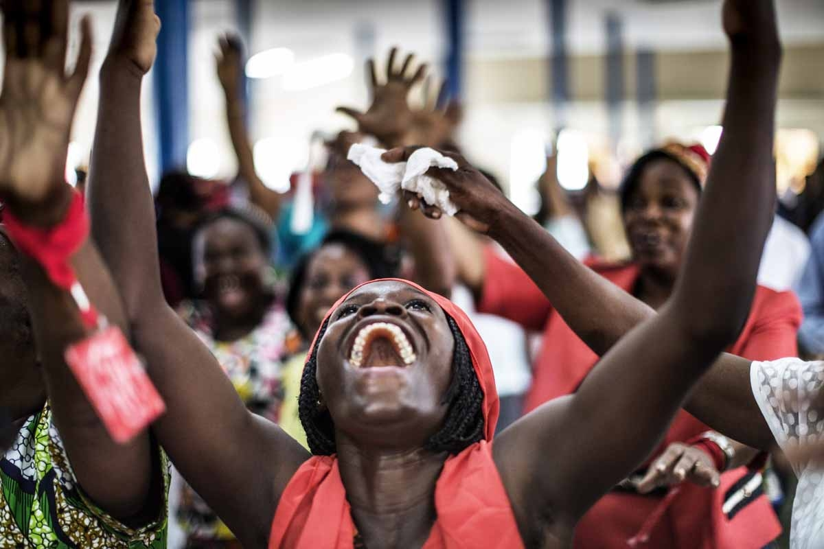 Christians dance on September 4, 2016 in Libreville, during the Sunday service at the Nazareth Evangelical Church which belongs to Pastor Georges Bruno Ngoussi.