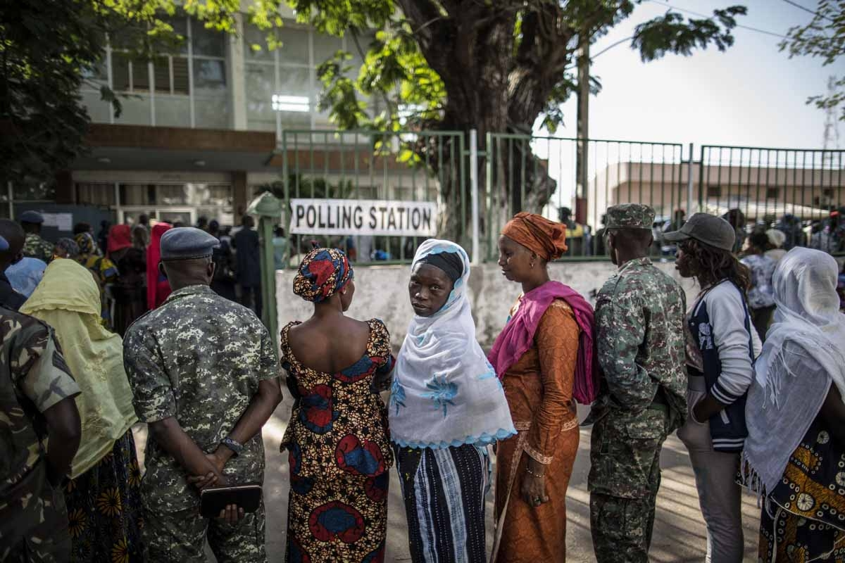 Voters queue at a polling station in Banjul on December 1, 2016, during presidential elections.