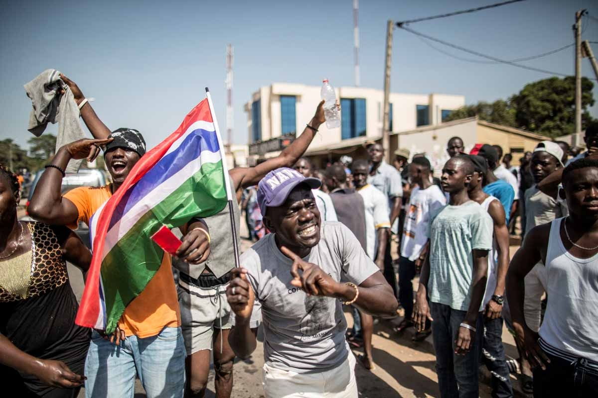 A man waves a Gambian flag as he celebrates the victory of Gambia's opposition candidate Adama Barrow during the Presidential Elections on December 2, 2016, in Serekunda, Banjul.