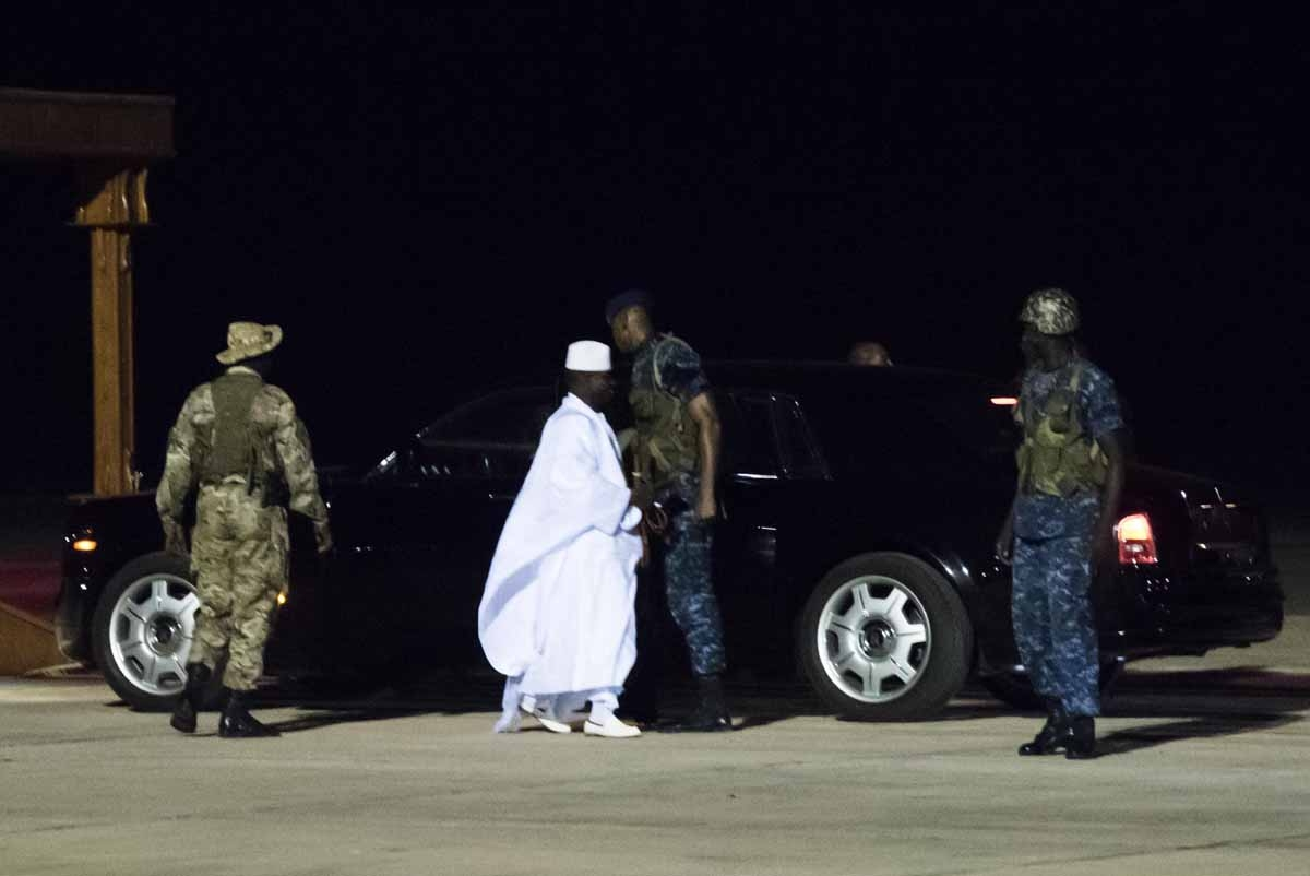Former president Yaya Jammeh (C), the Gambia's leader for 22 years, walks towards the plane as he leaves the country on 21 January 2017 in Banjul airport.
