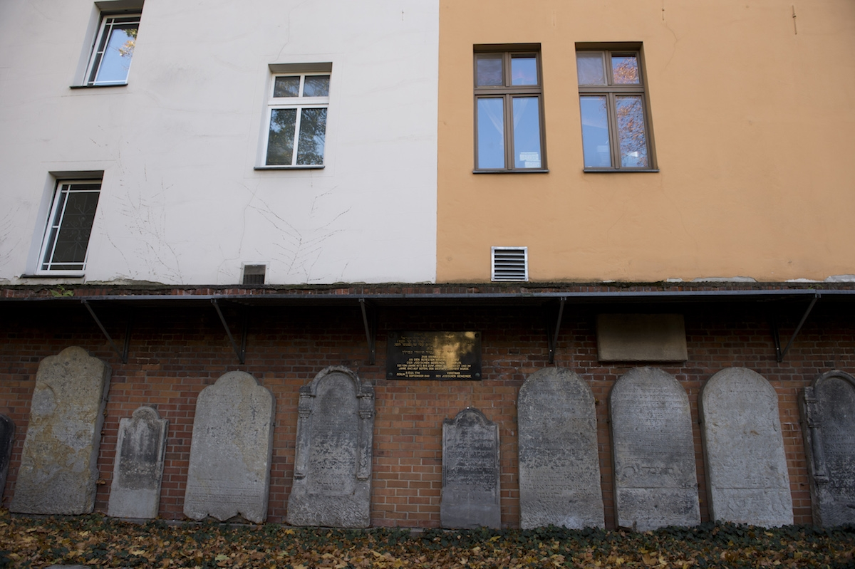 Tombstones are on display October 31, 2013 against a wall of Berlin's oldest Jewish cemetery in the German capital's district of Mitte.