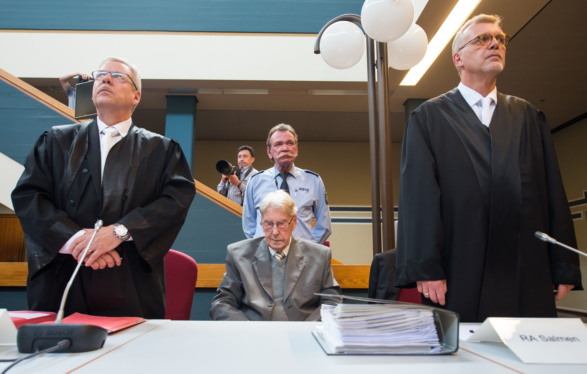 Former SS officer Reinhold Hanning (C) sits next to his lawyers Andreas Scharmer (L) and Johannes Salmen (R) at a court in Detmold, western Germany, on June 17, 2016, during the last day of his trial
