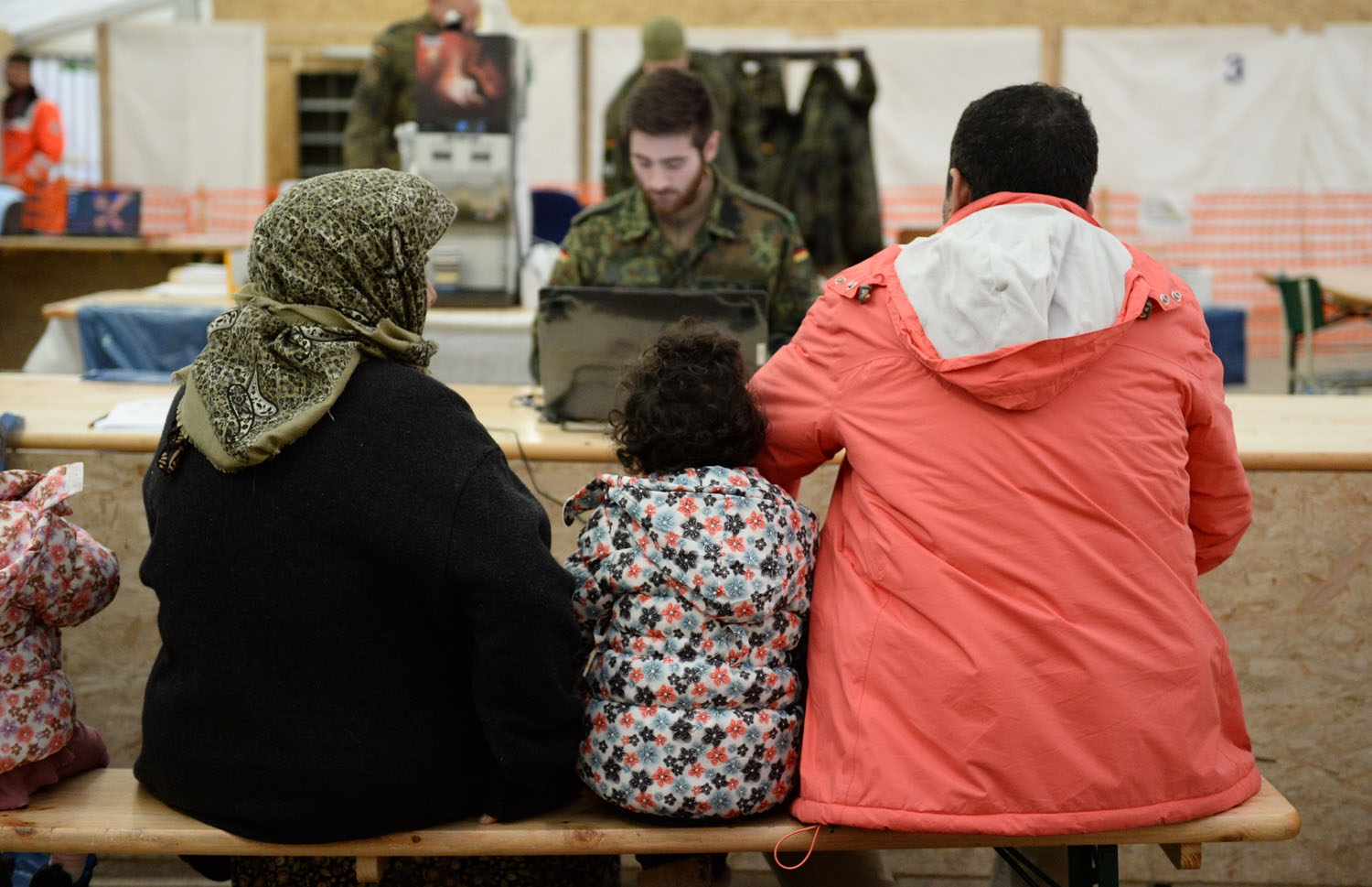 Refugees from Syria wait to register at the German army's air base in Erding, southern Germany, on January 31, 2016