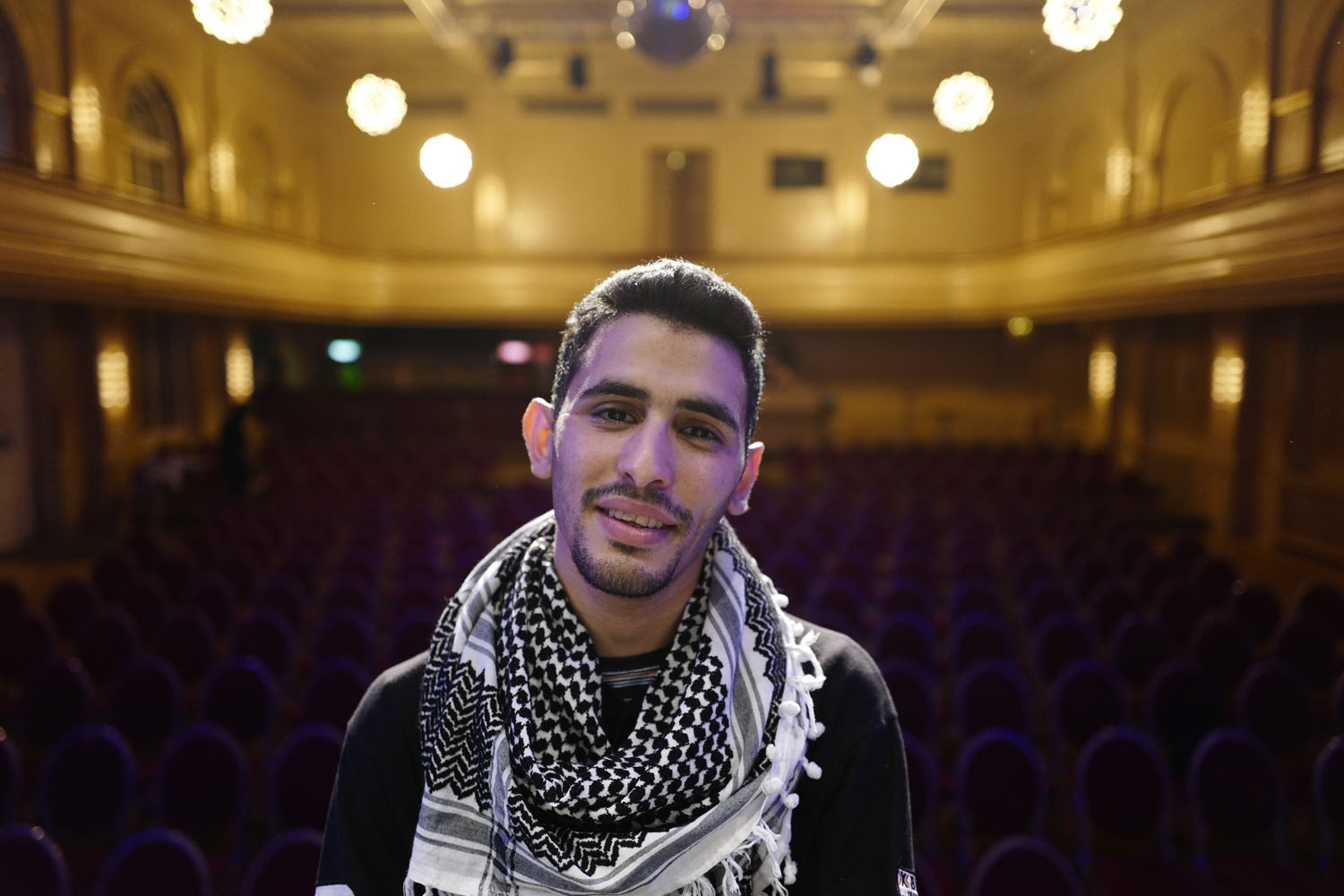 Palestinian/Syrian refugee Ayham Ahmad, also known as the pianist of Yarmouk poses prior to a performance at Berlin's Heimathafen concert hall on May 12, 2016
