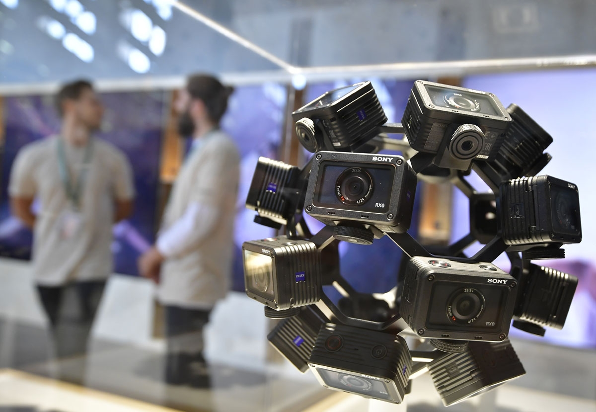 Fair workers stand behind an installation of RX0 cameras aimed at the virtual-reality and remote camera shooting markets at the booth of Sony at the IFA Consumer Electronics Fair in Berlin in Berlin on August 31, 2017.