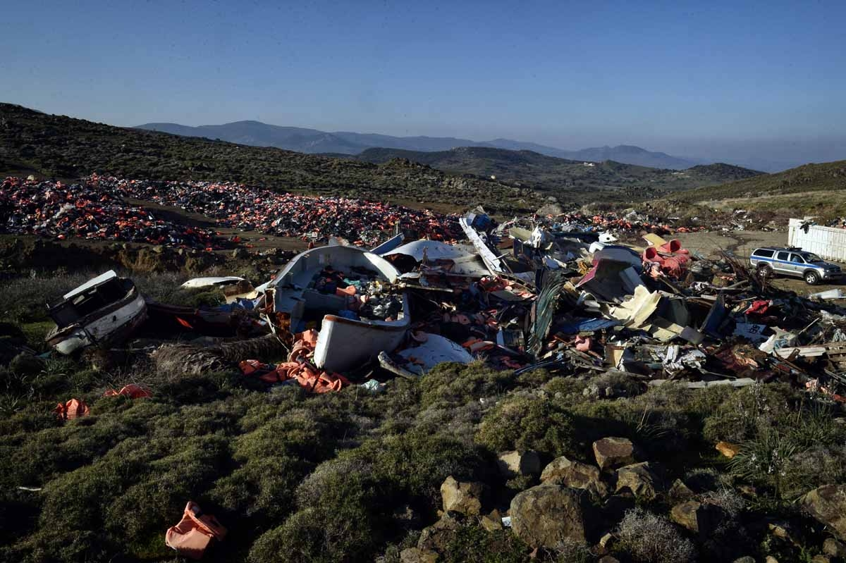 Portugese officers serving for the European Border and Coast Guard Agency and Greek  patrol along a dump with thousands of discarted lifejackets and boats used by migrants, during their patrol in Aghios Stephanos at the north part of the island of  Lesbos